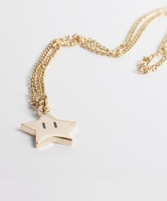 Royal Power Star Necklace by Sanshee ($15.99). This site has some great retro gaming jewelry!