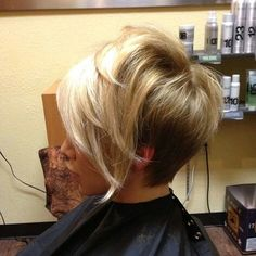 Asymmetrical haircut stacked wedge in the back