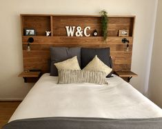 DIY Wooden Headboard with Shelves LOVE this wooden headboard with shelves my husband made for us. Related posts: Best stunning diy headboard with shelves ideas 34 Plans for Recycling Old Wooden Pallets. Diy Wooden Headboard With Lights Headboard With Shelves, Bookcase Headboard, Bed Frame With Storage, Diy Bed Frame, Diy Storage Headboard, Headboards With Storage, Wooden Storage Beds, Attach Headboard To Wall, Bed With Shelves