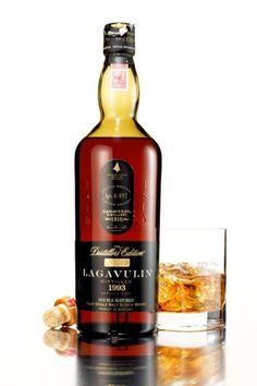 Lagavulin Distillers Edition - Smoke and butterscotch, dried fruit and leather: This delicious spirit is what happens when you take an amply peated whisky from the Islay region of Scotland and age it in sherry casks. Good Whiskey, Cigars And Whiskey, Scotch Whiskey, Bourbon Whiskey, Whiskey Bottle, Smoked Whiskey, Cocktail Drinks, Alcoholic Drinks, Tequila
