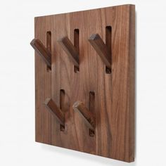 Ethnicraft Walnut Wall Bracket Hooks    Ethnicraft creates timeless, functional furniture by melding minimalist design with the tactile warmth of natural wood. These stowable walnut hooks are ideal for entryway organization and are pleasing to the eye even when not in use. Entryway Organization, Wall Brackets, Minimalist Design, Natural Wood, Eagle Pass, Hooks, Modern Furniture, Storage, Foyer