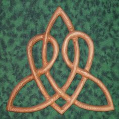 "Celtic Heart Love Knot Triquetra of Everlasting Love Wood Carved     MEANING:  The Heart shape evokes love and it is formed from one continuous line that represents eternity. This symbol expresses ""Everlasting Love."" The Celtic Heart is a variation of the original Triquetra Knot.     This (and any of the ""Love Knots"") are wonderful gifts for a wedding, anniversary, Valentine's day...   $68.00"