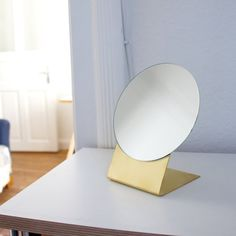 Beautiful mirror with a stand made of brass.  Brass is a beautiful material that can be recycled without any loss of quality. It will get a patina over