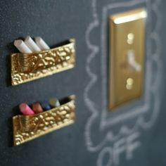This is a brilliant idea. Mount drawer pulls upside down to hold the chalk for your chalkboard wall! (via Dimples & Tangles)