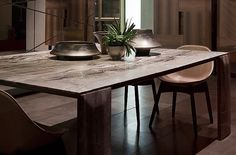 Materials coupled dining table, microsandblasted cappuccino stone and black eucalyptus thermo, with hand applied vegetal oil finish based on natural wax.  Dimension: 160x210x75cm  http://www.henge07.com/