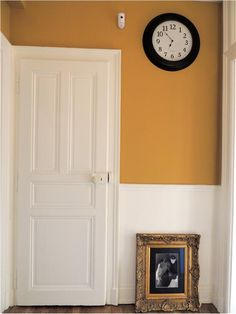 An inspirational image from Farrow and Ball.  India Yellow and White paneling and door, think this would look fab in kitchen