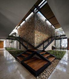 Casa L is a contemporary house featuring a stone wall and refreshing indoor vegetation. Designed by Located in Merida, Mexico 🇲🇽 Photos by - Mexico 100 Home Decoration Ideas Casa L is a contemporary house featuring a stone Architecture Design, Stairs Architecture, Modern Architecture House, Minimal Architecture, Creative Architecture, Architecture Student, New Staircase, Staircase Design, Home Design
