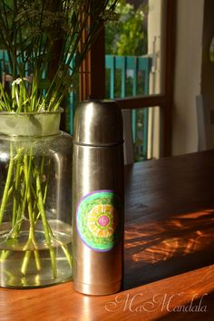 MaMandala, sticker on Thermos flask, mandala with birch, on table, teak, old glass