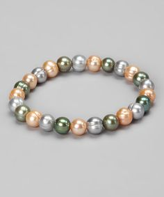 Take a look at this Champagne & Green Freshwater Pearl Circle Stretch Bracelet by KWAN COLLECTIONS on #zulily today!