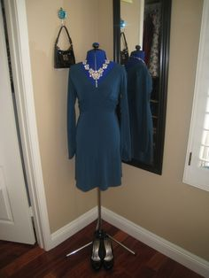 teal v neck dress, statement necklace, stella and dot, jewelry, party, black pumps, black purse, Dooney and Bourke, Bling, Charlotte Russe, fit and flare, dress, fancy, occasion