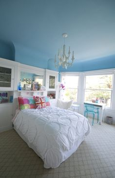 Lisa's Colorful, Art-Filled Home. Blue ceiling in a bright and bold kid's room.