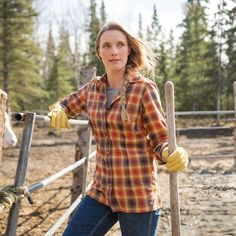 Nora working in our Women's Free Swingin' Flannel Shirt #65505 and new DuluthFlex® Work Denim Curvy Boot Cut Jeans #40705.