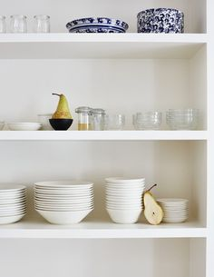 Decluttering by houzz. Image credit: A+B Kasha Designs: How to pare down your stuff and keep your home 'clean and spacious'. #Decluttering