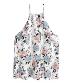 White/floral. Wide-cut top in woven fabric with narrow shoulder straps. Ruffles at top, back and front.