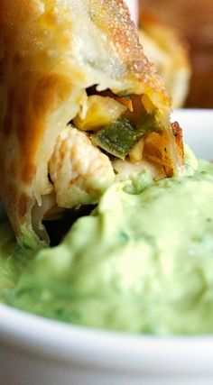 Copycat Chili's easy to make southwestern egg rolls with avocado cilantro sauce. Egg rolls can be baked or fried. You can freeze them for later use too! Wonton Recipes, Egg Roll Recipes, Avocado Recipes, Sauce Recipes, Seafood Recipes, Mexican Food Recipes, Cooking Recipes, Mexican Meals, Finger Food Appetizers