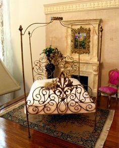 "Dollhouse Miniature 1:12 Scale Artisan Un-dressed Wrought Iron Canopy Bed ""Allegra"". $75.00, via Etsy."