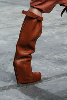 Orange brown leather knee high platform wedge boots. Rick Owens, RTW Spring / Summer 2012. Photo: Gianni Pucci / In Digital Images