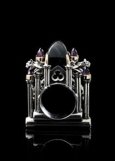 Cathedral Ring by MetalCoutureJewelry. Sterling silver, and gold, a central labrodorite stone and smaller amethyst stones. There are crouching gargoyles on the sides of the ring. It can be handcrafted to any size