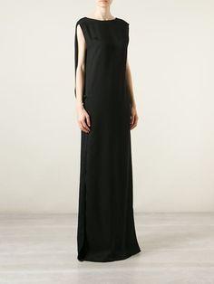Este es un vestido que usted puede llevar a un lugar elegante . Todo es negro y no apretado. Me gusta mucho este vestido de Farfetch .