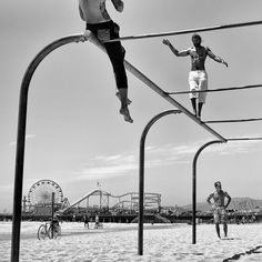 Fitness enthusiasts play in the historic Muscle Beach on Santa Monica Beach with…