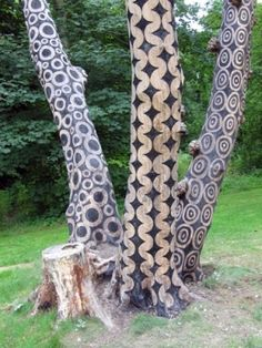 Well... if you can't cut it down.... decorate it... :) burned designs into the wood of dead trees... I would also add some flower pots for some color...