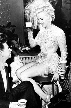 """Marilyn Monroe during a break from """"There's No Business Like Show Business"""", 1954, talking to Donald O'Connor"""