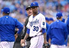 Kansas City Royals starting pitcher Yordano Ventura (30) stares at Oakland Athletics' Brett Lawrie standing on first as Ventura is escorted off the field after hitting Lawrie with a pitch in the fourth inning during Saturday's baseball game on April 18, 2015 at Kauffman Stadium in Kansas City, Mo.