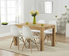 Buy the Verona 120cm Solid Oak Extending Dining Table with Charles Eames Style DSR Eiffel Chairs at Oak Furniture Superstore