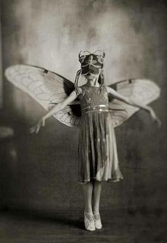 Vintage photo of little girl ballerina in pointe shoes and butterfly wings…