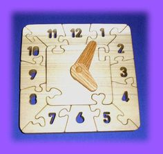 Clock - Learn to tell time - A Fun Wood Puzzle Game - New Toy - Hand Made - Child Safe. $24.95, via Etsy.