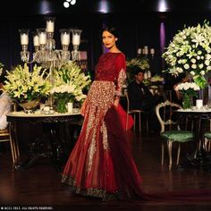 Krishna Somani showcases a creation by designer Manish Malhotra on Day 5 of Delhi Couture Week, held in New Delhi, on August 04, 2013.