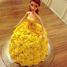 My lovely friend Jaimee made this cake. Target Belle bathtub disney doll. Her corset is a part of her body and looks better with the cake then clothing. J had the idea to use roses, and cover it in gold dusting. Michael's Wilton's yellow dye. Pipped on wedding ring, earrings and shoulder detail.