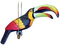This beautiful paper mache toucan was hand formed and hand painted in the studio of Mundo Pequeno. A colorful addition to any decor, this exquisite piece of artwork is perfect for brightening up any room and makes a great Christmas, anniversary or birthday gift.