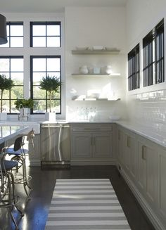 kitchen with lower cabinetry only Love the dark interior window frame with white trim, color of cabinets