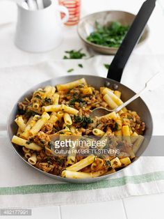Stock Photo : Pan of pasta with meat and herbs Griddle Pan, Paella, Herbs, Meat, Ethnic Recipes, Food, Grill Pan, Herb, Meals