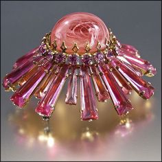 Schreiner Ruffle Brooch / Pin / Pendant - Pretty in Pink. The unusual Czech keystone shaped glass stones were made exclusively for Schreiner for only a short time during the 1950's and 1960's, and so are only seen on Henry Schreiner's pieces where they are set upside down, another Schreiner hallmark.
