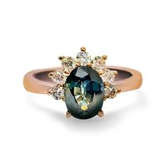 Oval Peacock Sapphire ring set in a half halo with 7 round 4 pointer white diamonds in 18 karat rose gold. Pretty Rings, Halo Diamond, Peacock, Sapphire, Gemstone Rings, Fine Jewelry, Rose Gold, Engagement Rings, Beautiful Things