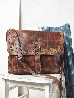 Thames Messenger Bag | Washed leather messenger with stud detailing and double O-rings with strap. Snap closures, with front pocket.