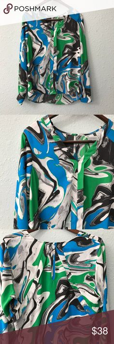 Yoana Boraschi printed blouse w/ interesting back This gorgeous blouse from high end designer Yoana Boraschi features a beautiful fluid pattern and an interesting design on the back. Measurements are shown in the pictures. It is in EUC with no holes, rips, or stains. Bundle with other items from my closet for the best deal! Yoana Baraschi Tops Blouses