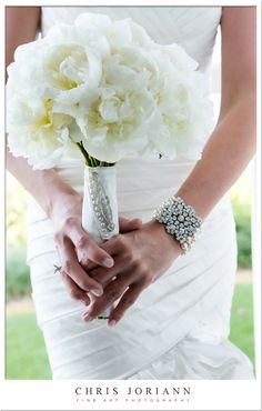 This gorgeous bridal bouquet of pure white peonies @Four Seasons Resort Palm Beach was created by Camden Gardens.
