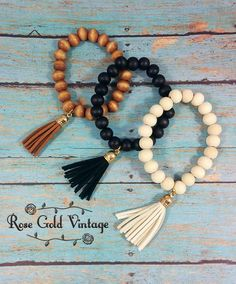 We can't get enough of these Tassel bracelets! Thisstyle features wooden beads with a coordinating faux leather tassel. Wear alone, or layer with any of our ot