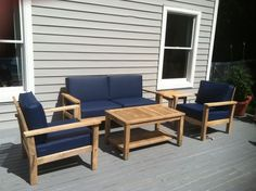 customer photo | teak patio set with Americana Navy blue marine-grade faux leather deep seating chair cushions