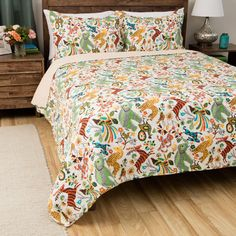 Bring all the animals home for fun with the Safari Park quilt set! A whimsical arrangement of elephant, zebra, rabbit, deer, monkey, giraffe, squirrel and peacock in festive, bright colors.