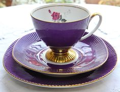 Continental Tea Trio in rich purple with pink flower details Related Post Satin Shelley Purple Bone China Tea Cup & Sau. Tea Cup Saucer, Tea Cups, Teapots And Cups, My Cup Of Tea, Chocolate Pots, High Tea, Afternoon Tea, Mauve, Tea Time
