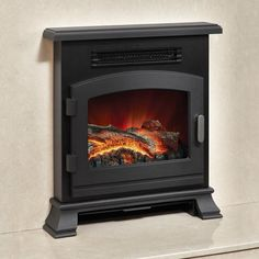 """Order now & get FREE UK Mainland delivery! Anthracite finish. Cheap in operation. 1 year warranty. Made in the UK. Realistic glowing log bed. Perfect for 16"""" fireplace openings. Easy to reach switches located on the side of the stove. 1kW/2kW heat settings + flame effect only. MPN: 133744, EAN: 5030478572551."""