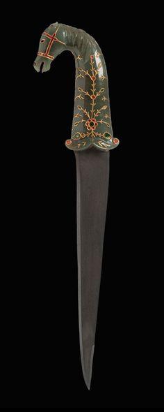 Khanjar dagger: ca. 1600 - 1650  Southern India – Deccan – Mughal Period (1526-1858)  Steel, jade, gold, rubies, emeralds, black and white agate.