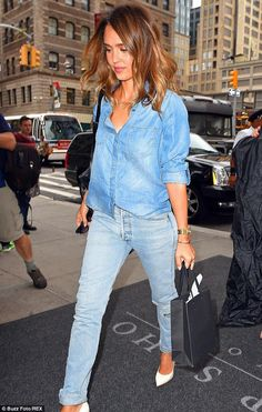 Choose a blue denim shirt and light blue destroyed boyfriend jeans to create a chic, glamorous look. Dress up this look with white leather pumps.   Shop this look on Lookastic: https://lookastic.com/women/looks/denim-shirt-boyfriend-jeans-pumps-crossbody-bag-sunglasses-watch/10724   — Blue Denim Shirt  — Black Leather Crossbody Bag  — Black Sunglasses  — Gold Watch  — Light Blue Ripped Boyfriend Jeans  — White Leather Pumps
