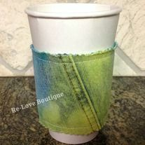 """This adorable and functional coffee """"cozy"""" is one of a kind!  Recycling the cardboard sleeve from a local coffee shop, it is sandwiched in between a piece of over dyed denim and an aqua solid fabric.   Wraps around securely with Velcro.  Surely to let your friends know that you are a bit of a..."""