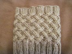 Ravelry: Cabled Boot Topper pattern by Anna Templer