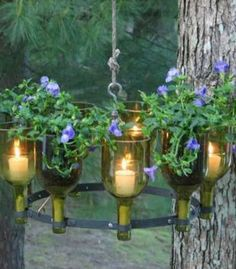 made with recycled wine bottle - chandelier with candles, flowers, & herbs Empty Wine Bottles, Recycled Wine Bottles, Wine Bottle Art, Lighted Wine Bottles, Bottle Lights, Wine Bottle Crafts, Glass Bottles, Wine Bottle Planter, Recycled Glass